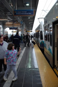Passengers exit light rail at the airport station. Photo by Willie Weir.